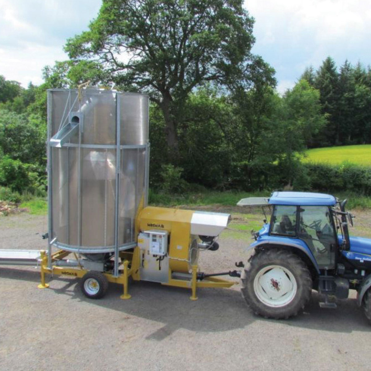tractor pulling grain drier